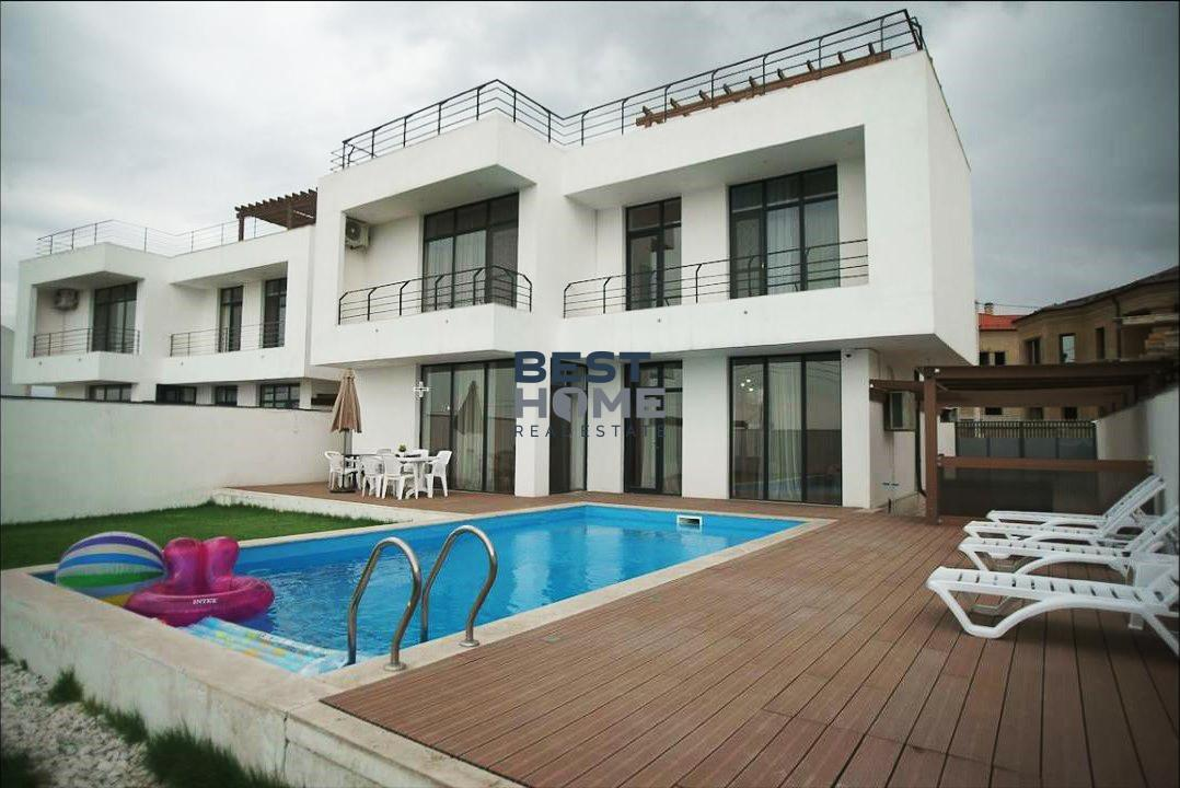 Modern two-storey villa with a pool and garden for rent